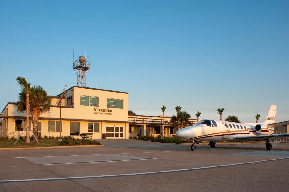 Scholes Airport with Small Airplane in Front